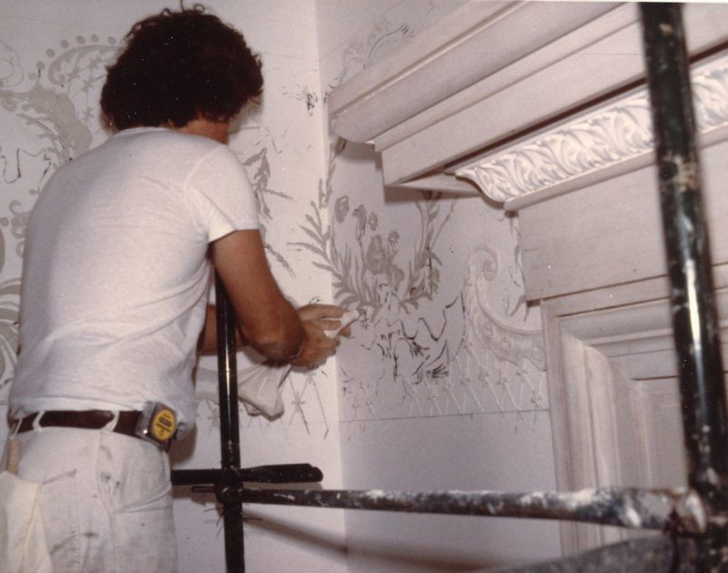 Artist Michael Casey applying plasterwork designs