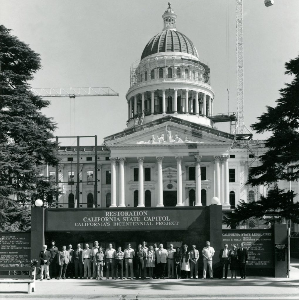 Members of the restoration team in front of the Capitol