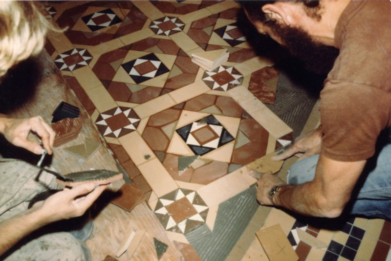 Workers laying Minton reproduction tiles in the rotunda