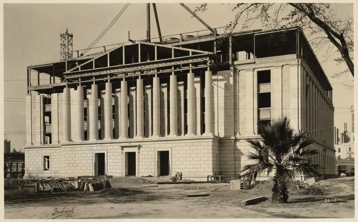 Work on the façade of the Library and Courts Building nears completion, c. 1925