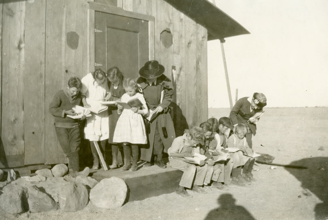 Children reading in front the Antelope branch of the Kern County Free Library, c. 1910s