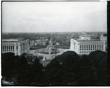1928 view from State Capitol dome looking west towards the newly completed Library and Courts Building (left) and State Building No. 1 (right)