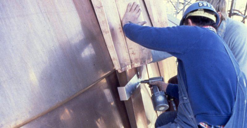 Applying metal sheeting to dome