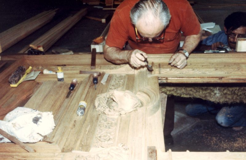 Finishing work on one of the Capitol's original doors
