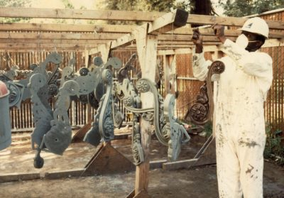 Metalworker hanging cast iron ornaments to dry