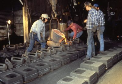 Pouring iron into casts
