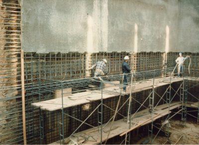 Shotcrete being applied to interior walls