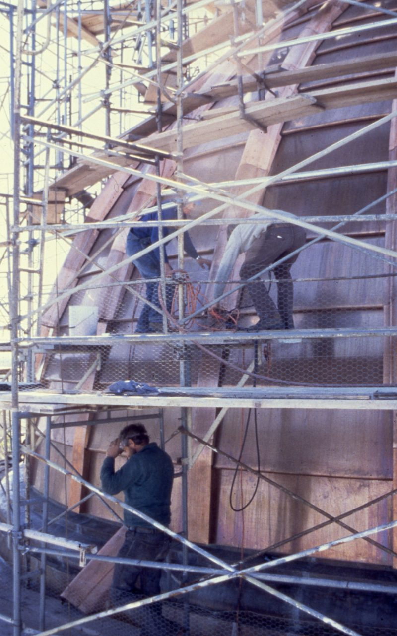 Working on metal exterior of dome