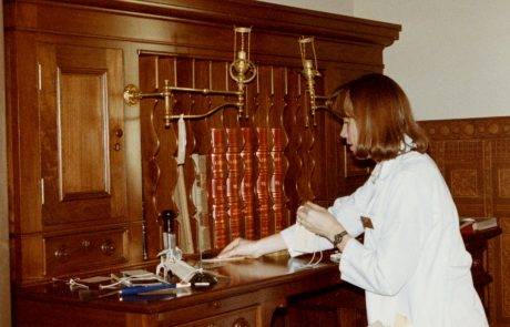 Museum staff placing historic objects